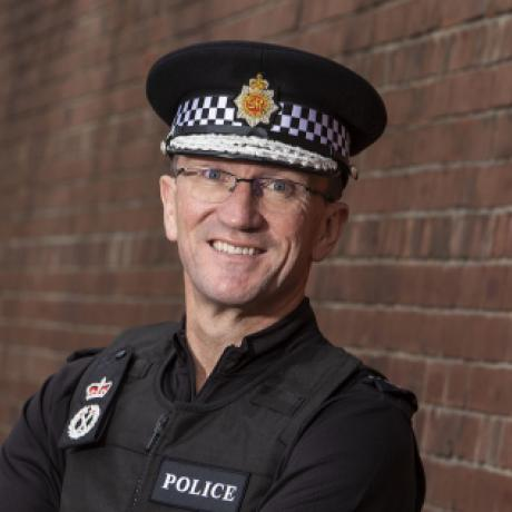 Ian Hopkins in uniform smiling
